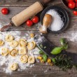 Top view on homemade pasta ravioli on old wooden t...
