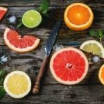 Set of sliced citrus fruits lemon, lime, orange, g...