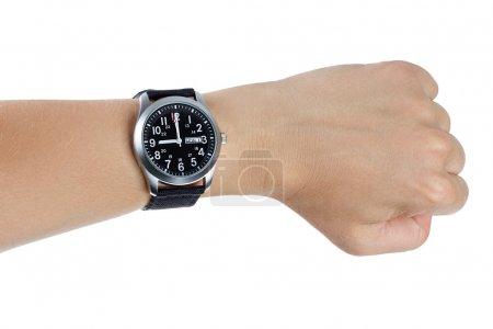 A hand wearing a black wrist watch