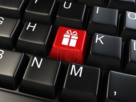 Photo pour Clavier d'ordinateur avec clé cadeau - fond de commerce - image libre de droit