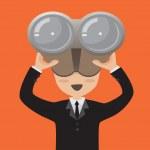 Businessman looking through binoculars....