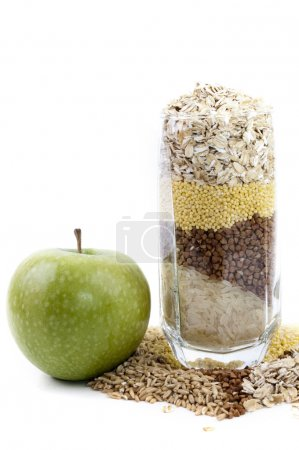 isolated set of cereals in glass and apple