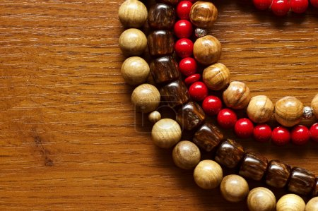 necklace and beads on a wooden background