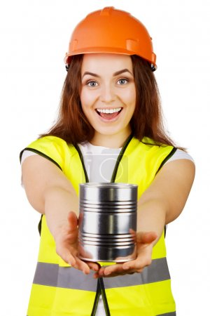Photo for Young woman builder with the cans in his outstretched hands. Looking directly. isolated. - Royalty Free Image