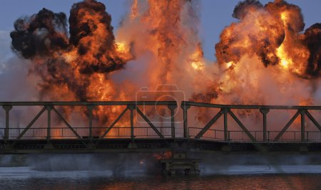 Photo for Explosion on a bridge over the river - Royalty Free Image