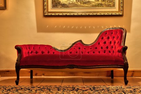 Expensive red sofa under painting