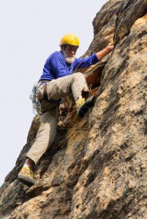 Senior climber in action