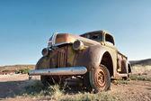 Rusty vintage car in desert