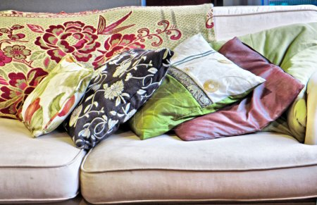 Stack of cushions on sofa