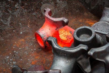Hot steel ingot in the workspace