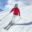 Young woman skiing. Alpes...