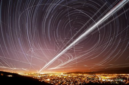 Photo for The accumulated light trails from the stars and air traffic above San Jose, California. - Royalty Free Image