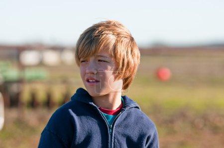 Boy with long hair looking sideways