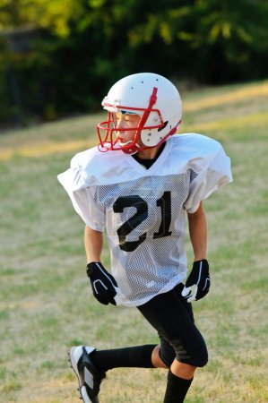Young football player looking back