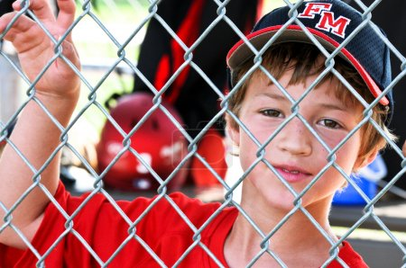 Youth baseball player in dugout