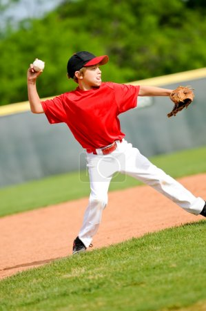 Youth ball player throwing ball
