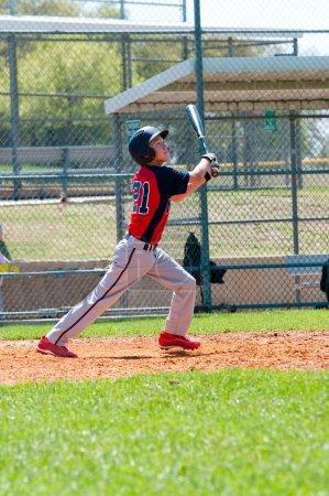 Teen baseball player at bat