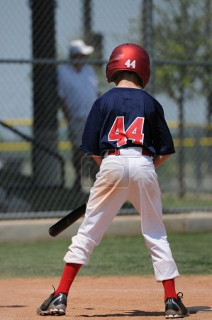 Young little league baseball player