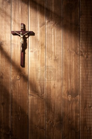 Photo for Suffering of Jesus Christ on the wooden wall. With shadows from a window frame. - Royalty Free Image