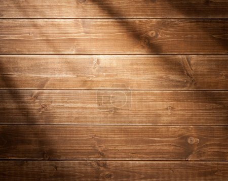 Photo for Wooden wall background in a morning light. With shadows from a window frame. - Royalty Free Image