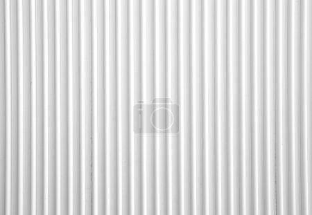 Photo pour Surface de texture en métal ondulé blanc ou galvaniser le fond en acier - image libre de droit