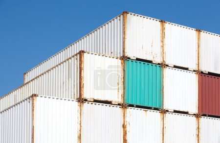 Photo for Stacked cargo containers in freight sea port terminal - Royalty Free Image