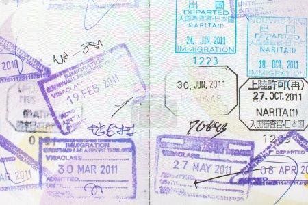 Foto de Sellos de pasaporte entrar en Japón, Thailand.Background - Imagen libre de derechos