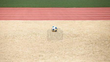 Football soccer ball on sand
