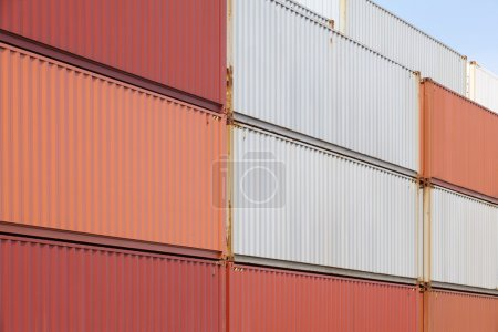 Stack of containers shipping at dockyard