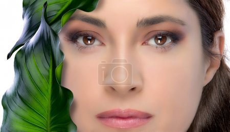 Photo for Spa beauty woman with green leaves on white background - Royalty Free Image