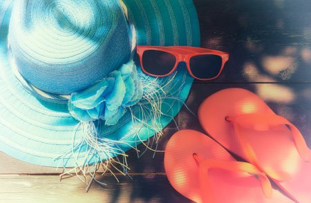 Photo for Summer accessories on a wooden background. faded effect - Royalty Free Image