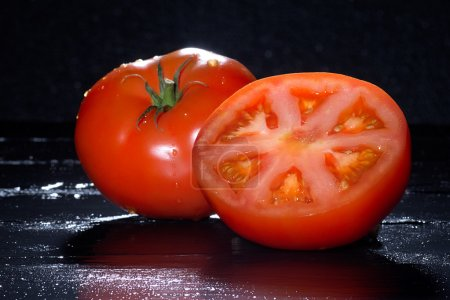 Photo for Closeup of fresh ripe and fleshy tomatoes - Royalty Free Image