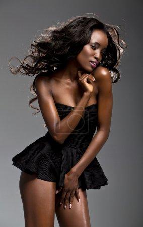 Sexy black girl posing in studio