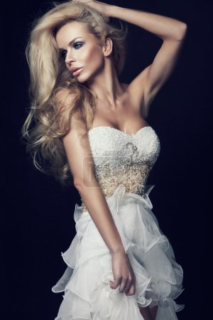 Cute blond woman in white wedding dress