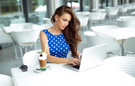 Photo for Young woman working on laptop - Royalty Free Image