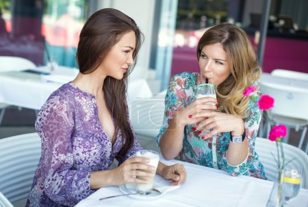 Women drinking coffee and talking