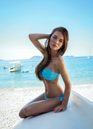 Sexy woman wearing blue swimwear on the beach