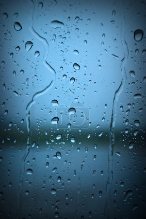 Raindrops on Blue Window