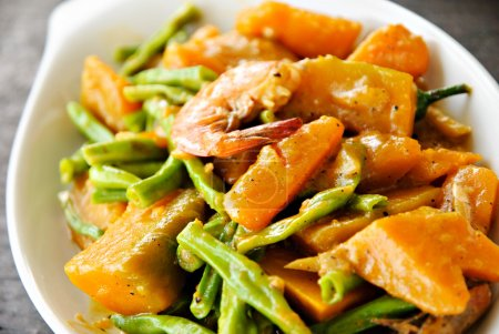 Asian Vegetable Cuisine with Seafood in Coconut Milk