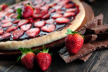 Photo for A Strawberry pizza on wooden background - Royalty Free Image