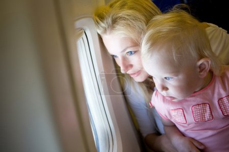 looking through the window of the plane