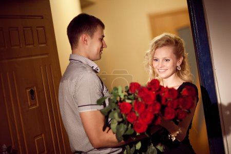 man gives roses to a girl