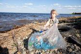 Small girl collecting rubbish