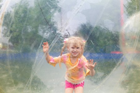 Photo for Happy child in the ball in water - Royalty Free Image