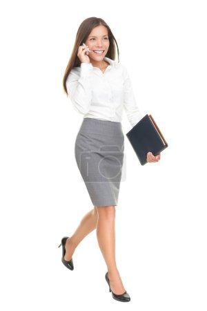 Businesswoman walking isolated