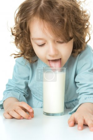 kid drinks milk