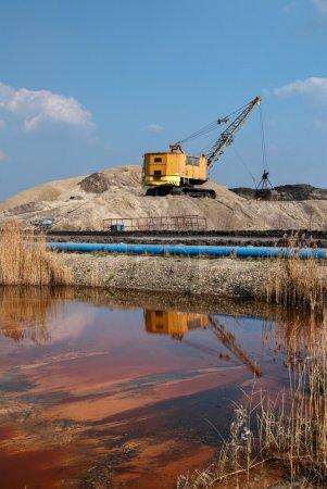Rope excavator for mining sludge