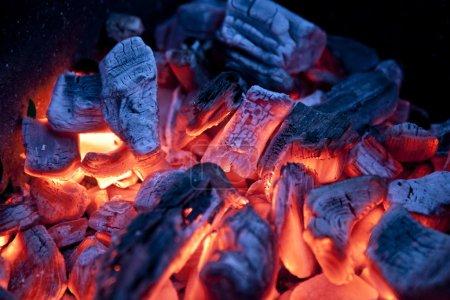 Burning campfire embers (hot coal)