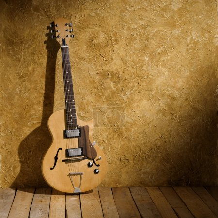 Photo for Vintage jazz guitar on aged wall - Royalty Free Image