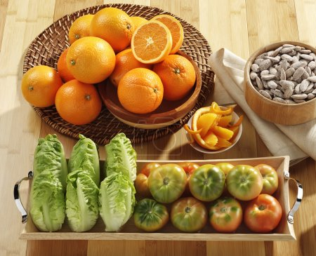 Photo for Oranges, almond, tomatoes and lettuces - Royalty Free Image
